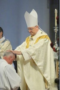 Archbishop lays hands on new deaacon