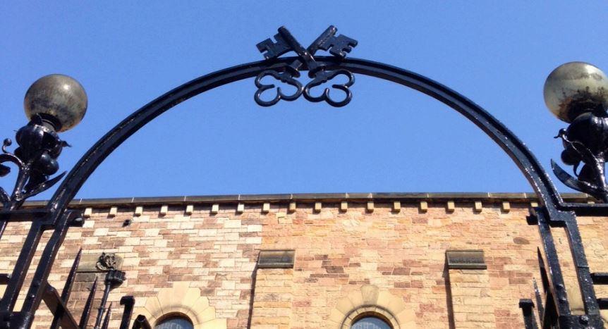 gate arch into church