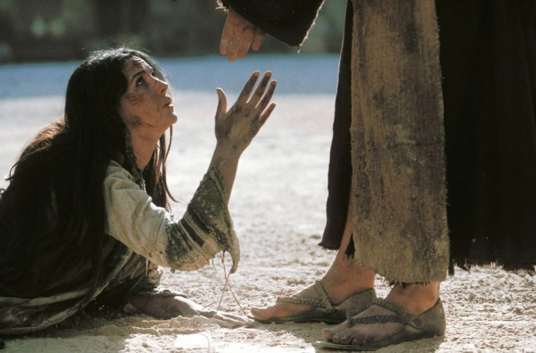 woman stretching hand out to Jesus
